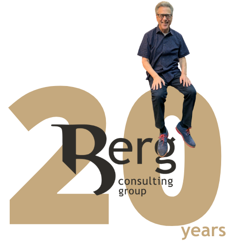 Bruce Berg sitting on top of 20 year Berg Consulting Group Logo